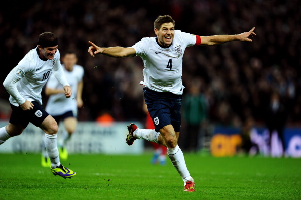 LONDON, ENGLAND - OCTOBER 15:  Steven Gerrard of England celebrates as he scores their second goal during the FIFA 2014 World Cup Qualifying Group H match between England and Poland at Wembley Stadium on October 15, 2013 in London, England.  (Photo by Laurence Griffiths/Getty Images)