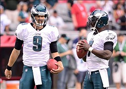 Sept. 23, 2012; Glendale, AZ, USA; Philadelphia Eagles quarterback Nick Foles (9) and quarterback Michael Vick (7) during the game against the Arizona Cardinals at University of Phoenix Stadium. The Cardinals defeated the Eagles 27 - 6. Mandatory Credit: Jennifer Stewart-USA TODAY Sports
