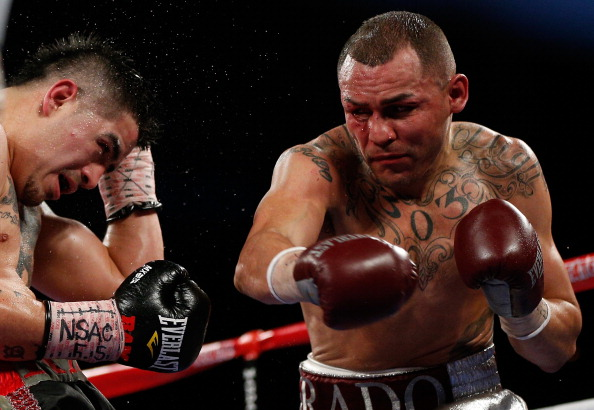 LAS VEGAS, NV - MARCH 30:  (R-L) Mike Alvarado lands a right to the head of Brandon Rios in their WBO interim junior welterweight championship bout at the Mandalay Bay Events Center on March 30, 2013 in Las Vegas, Nevada. (Photo by Josh Hedges/Getty Images)