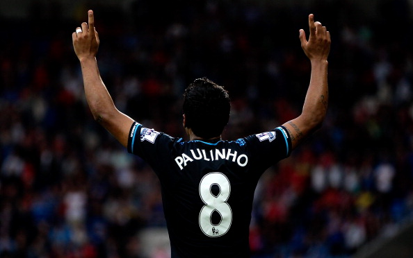 CARDIFF, WALES - SEPTEMBER 22:  Paulinho of Tottenham celebrates after scoring the winning goal during the Barclays Premier League match between Cardiff City and Tottenham Hotspur at Cardiff City Stadium on September 22, 2013 in Cardiff, Wales.  (Photo by Ben Hoskins/Getty Images)