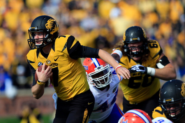 COLUMBIA, MO - OCTOBER 19:  Quarterback Maty Mauk #7 of the Missouri Tigers carries the ball upfield during the game against the Florida Gators at Faurot Field/Memorial Stadium on October 19, 2013 in Columbia, Missouri.  (Photo by Jamie Squire/Getty Images)