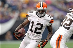 Sep 22, 2013; Minneapolis, MN, USA; Cleveland Browns wide receiver Josh Gordon (12) carries the ball during the first quarter against the Minnesota Vikings at Mall of America Field at H.H.H. Metrodome. Mandatory Credit: Brace Hemmelgarn-USA TODAY Sports