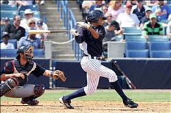 March 23, 2012; Tampa, FL, USA; New York Yankees outfielder Mason Williams (85) drives in a run in the seventh inning against the Minnesota Twins at George M. Steinbrenner Field. Mandatory Credit: Kim Klement-USA TODAY Sports