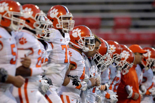 COLLEGE PARK, MD - OCTOBER 15:  Head coach Dabo Swinney of the Clemson Tigers (C) walks with his players on the field during warm-ups before the start of their game against the Maryland Terrapins at Byrd Stadium on October 15, 2011 in College Park, Maryland.  (Photo by Rob Carr/Getty Images)
