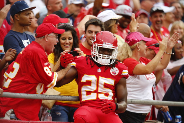 KANSAS CITY, MO - SEPTEMBER 15: Jamaal Charles #25 of the Kansas City Chiefs celebrates with the Kansas City Chiefs fans after scoring the first touchdown against the / in the first quarter September 15, 2013 at Arrowhead Stadium in Kansas City, Missouri. (Photo by Kyle Rivas/Getty Images)