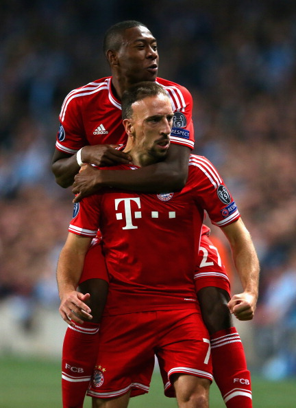 MANCHESTER, ENGLAND - OCTOBER 02:   Franck Ribery of Muenchen celebrates scoring the opening goal with David Alaba of Muenchen during the UEFA Champions League Group D match between Manchester City and FC Bayern Muenchen at Etihad Stadium on October 2, 2013 in Manchester, England. (Photo by Julian Finney/Getty Images)