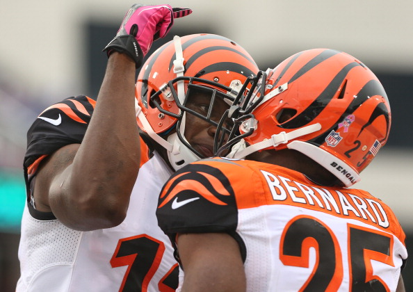 ORCHARD PARK, NY - OCTOBER 13: Giovani Bernard #25 of the Cincinnati Bengals is congratulated after scoring a touchdown by Mohamed Sanu #12 during NFL game action against the Buffalo Bills at Ralph Wilson Stadium on October 13, 2013 in Orchard Park, New York. (Photo by Tom Szczerbowski/Getty Images)
