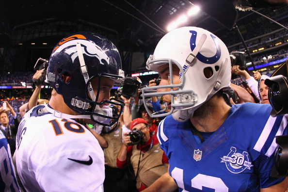 INDIANAPOLIS, IN - OCTOBER 20: Peyton Manning #18 of the Denver Broncos congratulates Andrew Luck #12 of the Indianapolis Colts after the Colts beat the Broncos 39-33 at Lucas Oil Stadium on October 20, 2013 in Indianapolis, Indiana.  (Photo by Dilip Vishwanat/Getty Images)