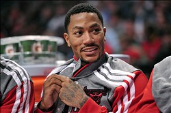 Oct 21, 2013; Chicago, IL, USA; Chicago Bulls point guard Derrick Rose (1) sits on the bench against the Milwaukee Bucks during the second half at the United Center. The Bulls beat the Bucks 105-84. Mandatory Credit: Rob Grabowski-USA TODAY Sports
