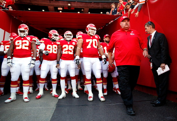 KANSAS CITY, MO - OCTOBER 20:  Head coach Andy Reid of the Kansas City Chiefs leads players onto the field during player introductions ahead of the game against the Houston Texans at Arrowhead Stadium on October 20, 2013 in Kansas City, Missouri.  (Photo by Jamie Squire/Getty Images)