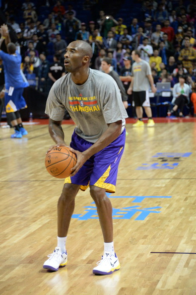 SHANGHAI, CHINA - OCTOBER 18: Kobe Bryant #24 of the Los Angeles Lakers warms up against the Golden State Warriors during the 2013 Global Games on October 18, 2013 at the Mercedes-Benz Arena in Shanghai, China. NOTE TO USER: User expressly acknowledges and agrees that, by downloading and/or using this photograph, user is consenting to the terms and conditions of the Getty Images License Agreement.  Mandatory Copyright Notice: Copyright 2013 NBAE (Photo by Andrew D. Bernstein/NBAE via Getty Images)
