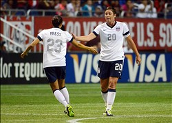 Oct 20, 2013; San Antonio, TX, USA; USA forwards Abby Wombach (20) and Christen Press (23) react against Australia during the second half at the Alamodome. USA beat Australia 4-0. Mandatory Credit: Brendan Maloney-USA TODAY Sports