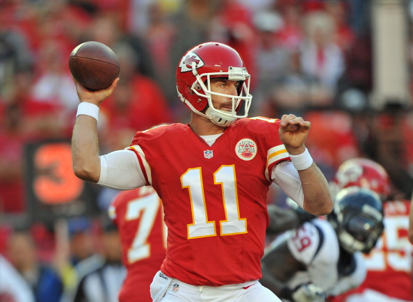 KANSAS CITY, MO - OCTOBER 20:  Quarterback Alex Smith #11 of the Kansas City Chiefs throws a pass against the Houston Texans during the first half on October 20, 2013 at Arrowhead Stadium in Kansas City, Missouri.  (Photo by Peter Aiken/Getty Images)