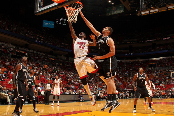 MIAMI, FL - OCTOBER 25: Udonis Haslem #40 of the Miami Heat shoots against Brook Lopez #11 of the Brooklyn Nets during a game on October 25, 2013 at American Airlines Arena in Miami, Florida. NOTE TO USER: User expressly acknowledges and agrees that, by downloading and/or using this photograph, user is consenting to the terms and conditions of the Getty Images License Agreement. Mandatory copyright notice: Copyright NBAE 2013 (Photo by Issac Baldizon/NBAE via Getty Images)