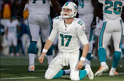 Oct 27, 2013; Foxborough, MA, USA; Miami Dolphins quarterback Ryan Tannehill (17) gets to his knees after being sacked during the fourth quarter of their 27-17 loss to the New England Patriots at Gillette Stadium. Mandatory Credit: Winslow Townson-USA TODAY Sports