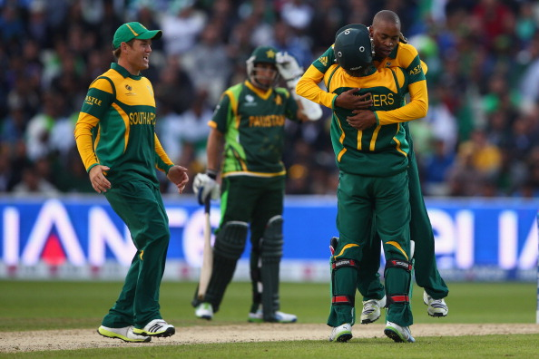 BIRMINGHAM, ENGLAND - JUNE 10:  Aaron Phangiso (R) of South Africa celebrates with captain AB de Villiers after taking the wicket of Wahab Riaz of Pakistan during the ICC Champions Trophy Group B match between Pakistan and South Africa at Edgbaston on June 10, 2013 in Birmingham, England.  (Photo by Michael Steele/Getty Images)