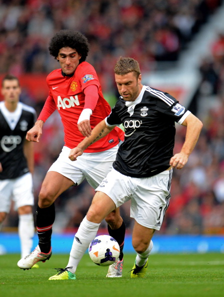 MANCHESTER, ENGLAND - OCTOBER 19:  Rickie Lambert of Southampton is pursued by Marouane Fellaini of Manchester United during the Barclays Premier League match between Manchester United and Southampton at Old Trafford on October 19, 2013 in Manchester, England.  (Photo by Shaun Botterill/Getty Images)