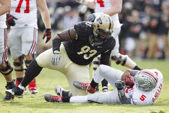 WEST LAFAYETTE, IN - NOVEMBER 12: Kawann Short #93 of the Purdue Boilermakers celebrates after sacking Braxton Miller #5 of the Ohio State Buckeyes at Ross-Ade Stadium on November 12, 2011 in West Lafayette, Indiana. Purdue defeated Ohio State 26-23 in overtime. (Photo by Joe Robbins/Getty Images)