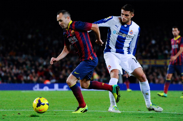 BARCELONA, SPAIN - NOVEMBER 01:  Andres Iniesta of FC Barcelona duels for the ball with David Lopez of RCD Espanyol during the La Liga match between FC Barcelona and RCD Espanyol at Camp Nou on November 1, 2013 in Barcelona, Spain.  (Photo by David Ramos/Getty Images)