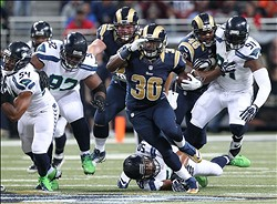 Oct 28, 2013; St. Louis, MO, USA; St. Louis Rams running back Zac Stacy (30) rushes as Seattle Seahawks linebacker K.J.Wright (50) attempts a tackle during the first half at Edward Jones Dome. Mandatory Credit: Nelson Chenault-USA TODAY Sports