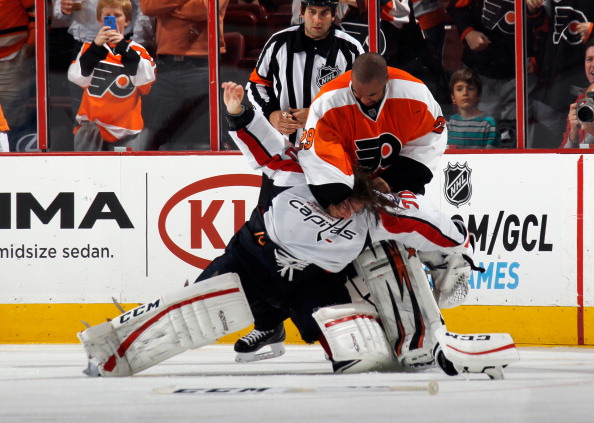 PHILADELPHIA, PA - NOVEMBER 01: Ray Emery #29 of the Philadelphia Flyers fights with Braden Holtby #70 of the Washington Capitals during the third period at the Wells Fargo Center on November 1, 2013 in Philadelphia, Pennsylvania. The Capitals shutout the Flyers 7-0. (Photo by Bruce Bennett/Getty Images)