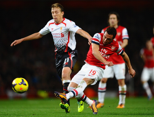 LONDON, ENGLAND - NOVEMBER 02:  Lucas Leiva of Liverpool and Santi Cazorla of Arsenal battle for the ball during the Barclays Premier League match between Arsenal and Liverpool at Emirates Stadium on November 2, 2013 in London, England.  (Photo by Laurence Griffiths/Getty Images)