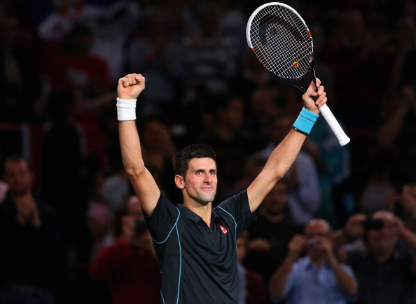 PARIS, FRANCE - NOVEMBER 02:  Novak Djokovic of Serbia celebrates defeating Roger Federer of Switzerland during day six of the BNP Paribas Masters at Palais Omnisports de Bercy on November 2, 2013 in Paris, France.  (Photo by Julian Finney/Getty Images)