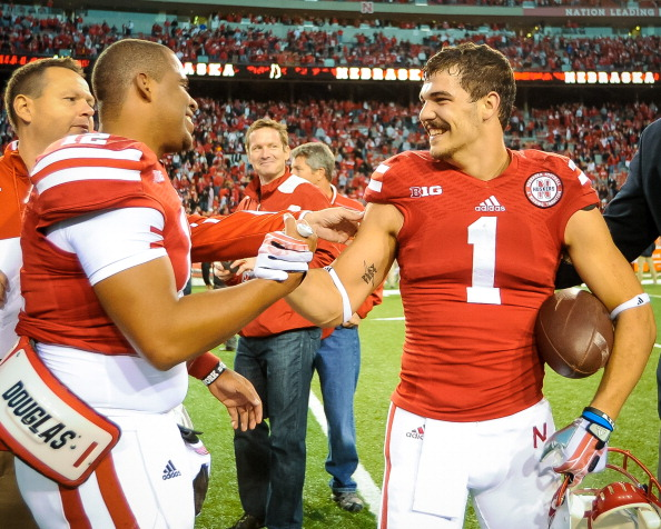 LINCOLN, NE - NOVEMBER 2: Quarterback Ron Kellogg III #12 of the Nebraska Cornhuskers celebrates with wide receiver Jordan Westerkamp #1 of the Nebraska Cornhuskers after defeating the Northwestern Wildcats with a hail mary touchdown as time ran out at Memorial Stadium on November 2, 2013 in Lincoln, Nebraska. (Photo by Eric Francis/Getty Images)