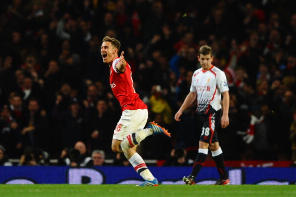LONDON, ENGLAND - NOVEMBER 02: Aaron Ramsey of Arsenal celebrates scoring their second goal during the Barclays Premier League match between Arsenal and Liverpool at Emirates Stadium on November 2, 2013 in London, England.  (Photo by Laurence Griffiths/Getty Images)