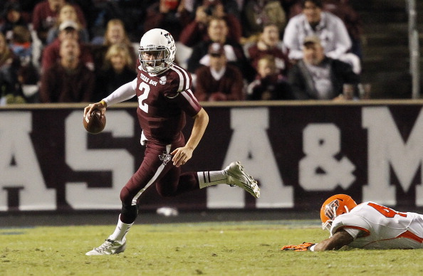 COLLEGE STATION, TX - NOVEMBER 02:  Johnny Manziel #2 of the Texas A&M Aggies scrambles out of the pocket against the UTEP Miners at Kyle Field on November 2, 2013 in College Station, Texas.  (Photo by Bob Levey/Getty Images)