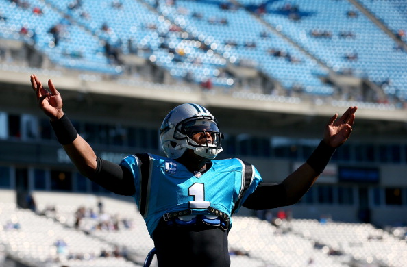 CHARLOTTE, NC - NOVEMBER 03:  Cam Newton #1 of the Carolina Panthers reacts to the fans as he warms up before their game against the Atlanta Falcons at Bank of America Stadium on November 3, 2013 in Charlotte, North Carolina.  (Photo by Streeter Lecka/Getty Images)