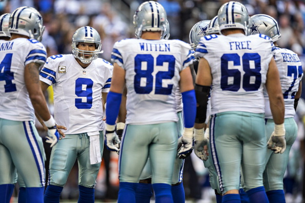 ARLINGTON, TX - NOVEMBER 3:  Tony Romo #9 of the Dallas Cowboys in the huddle during a game against the Minnesota Vikings at AT&T Stadium on November 3, 2013 in Arlington, Texas.  The Cowboys defeated the Vikings 27-23.  (Photo by Wesley Hitt/Getty Images)