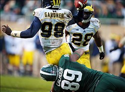 Nov 2, 2013; East Lansing, MI, USA; Michigan Wolverines quarterback Devin Gardner (98) is sacked by Michigan State Spartans defensive end Shilique Calhoun (89) during the 2nd half of a game at Spartan Stadium. MSU won 29-6. Mandatory Credit: Mike Carter-USA TODAY Sports