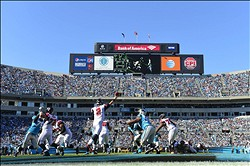 Nov 3, 2013; Charlotte, NC, USA; Atlanta Falcons quarterback Matt Ryan (2) throws the ball as Carolina Panthers defensive tackle Linden Gaydosh (98) pressures in the second quarter at Bank of America Stadium. Mandatory Credit: Bob Donnan-USA TODAY Sports