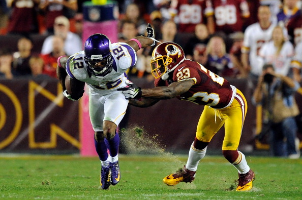 LANDOVER, MD - OCTOBER 14:  Percy Harvin #12 of the Minnesota Vikings breaks the tackle of DeAngelo Hall #23 of the Washington Redskins during the second half at FedExField on October 14, 2012 in Landover, Maryland.  (Photo by Patrick McDermott/Getty Images)