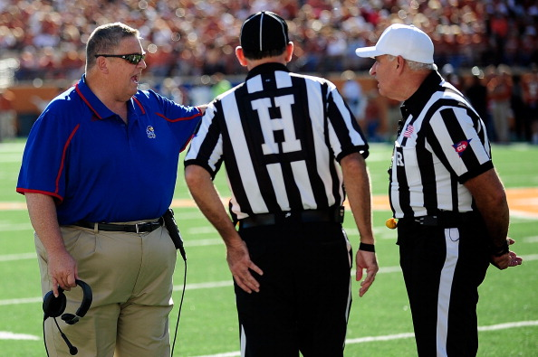 AUSTIN, TX - NOVEMBER 02:  Charlie Weis, head coach of the Kansas Jayhawks, argues an official's call during a game against the Texas Longhorns at Darrell K Royal-Texas Memorial Stadium on November 2, 2013 in Austin, Texas.  Texas won the game 35-13.  (Photo by Stacy Revere/Getty Images)