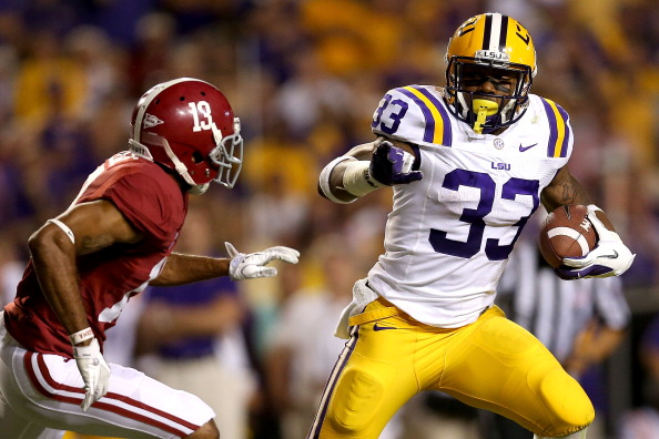 BATON ROUGE, LA - NOVEMBER 03:  Jeremy Hill #33 of LSU carries the ball against Deion Belue #13 of Alabama at Tiger Stadium on November 3, 2012 in Baton Rouge, Louisiana.  (Photo by Matthew Stockman/Getty Images)