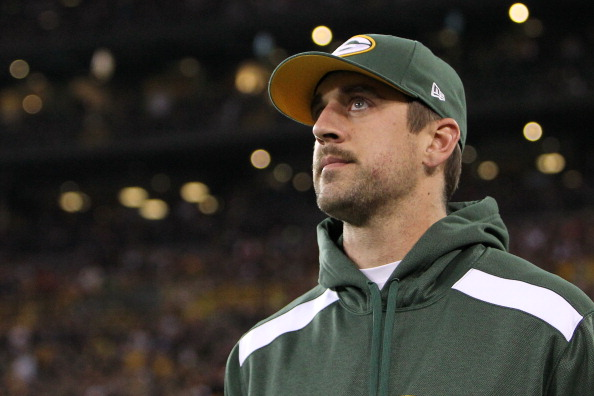 GREEN BAY, WI - NOVEMBER 04: Aaron Rodgers #12 of the Green Bay Packers returns to the field after a colar bone injury which occurred in the first half of the game against the Chicago Bears during the game at Lambeau Field on November 04, 2013 in Green Bay, Wisconsin. (Photo by Mike McGinnis/Getty Images)