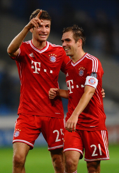 MANCHESTER, ENGLAND - OCTOBER 02:  Thomas Muller and Philipp Lahm of FC Bayern Muenchen celebrates during the UEFA Champions League Group D match between Manchester City and  FC Bayern Muenchen at Etihad Stadium on October 2, 2013 in Manchester, England.  (Photo by Laurence Griffiths/Getty Images)