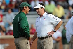 Nov 10, 2012; Norman, OK, USA; Baylor Bears head coach Art Briles (left) talks with Oklahoma Sooners head coach Bob Stoops before the game at Oklahoma Memorial Stadium. The Sooners won 42-34. Mandatory Credit: Denny Medley-USA TODAY Sports