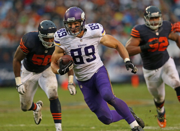 CHICAGO, IL - SEPTEMBER 15:  John Carlson #89 of the Minnesota Vikings is chased by James Anderson #50 and Stephen Paea #92 of the Chicago Bears at Soldier Field on September 15, 2013 in Chicago, Illinois. The Bears defeated the Vikings 31-30.  (Photo by Jonathan Daniel/Getty Images)