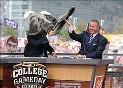 Sep 1, 2012; Arlington, TX, USA; ESPN analyst Lee Corso (left) wears the Alabama mascot head as analyst Kirk Herbstreit (right) laughs on the set of ESPN College Gameday before the game between the Alabama Crimson Tide and the Michigan Wolverines at Cowboys Stadium. Mandatory Credit: Kevin Jairaj-USA TODAY Sports