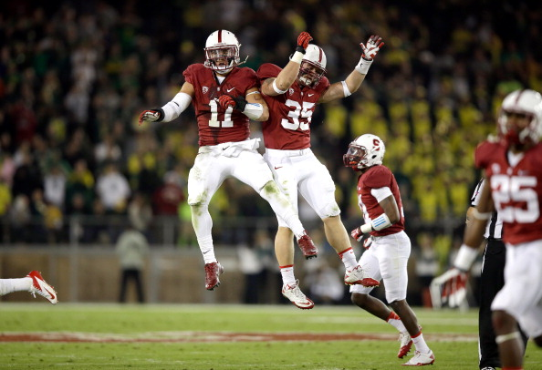 PALO ALTO, CA - NOVEMBER 07:  Shayne Skov #11 and Jarek Lancaster #35 of the Stanford Cardinal celebrate after Lancaster recovered a fumble during their game against the Oregon Ducks at Stanford Stadium on November 7, 2013 in Palo Alto, California.  (Photo by Ezra Shaw/Getty Images)