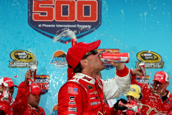 AVONDALE, AZ - NOVEMBER 10:  Kevin Harvick, driver of the #29 Budweiser Chevrolet, celebrates in victory lane after winning the NASCAR Sprint Cup Series AdvoCare 500 at Phoenix International Raceway on November 10, 2013 in Avondale, Arizona.  (Photo by Jonathan Ferrey/Getty Images)