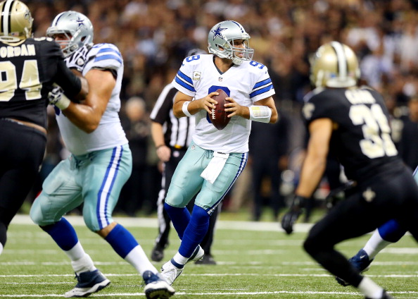 NEW ORLEANS, LA - NOVEMBER 10:  Quarterback Tony Romo #9 of the Dallas Cowboys drops back to pass against the New Orleans Saints during a game at the Mercedes-Benz Superdome on November 10, 2013 in New Orleans, Louisiana.  (Photo by Ronald Martinez/Getty Images)
