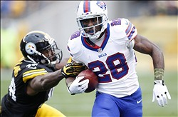 Nov 10, 2013; Pittsburgh, PA, USA; Buffalo Bills running back C.J. Spiller (28) rushes the ball against the Pittsburgh Steelers during the first quarter at Heinz Field. Mandatory Credit: Charles LeClaire-USA TODAY Sports