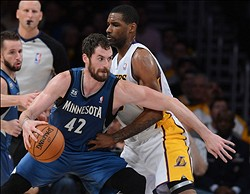 Nov 10, 2013; Los Angeles, CA, USA;   Los Angeles Lakers power forward Shawne Williams (3) guards Minnesota Timberwolves power forward Kevin Love (42) in the second half of the game at Staples Center. Timberwolves won 113-90. Mandatory Credit: Jayne Kamin-Oncea-USA TODAY Sports