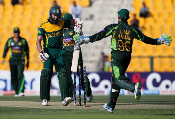 ABU DHABI, UNITED ARAB EMIRATES - NOVEMBER 06: Hashim Amla of South Africa reacts after being dismissed by Pakistan bowler Mohammad Irfan during the third One Day International between Pakistan and South Africa at Sheikh Zayed Stadium on November 06, 2013 in Abu Dhabi, United Arab Emirates.  (Photo by Francois Nel/Getty Images)