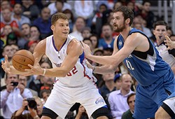 Nov 11, 2013; Los Angeles, CA, USA; Los Angeles Clippers forward Blake Griffin (32) is defended by Minnesota Timberwolves forward Kevin Love (42) at Staples Center. Mandatory Credit: Kirby Lee-USA TODAY Sports