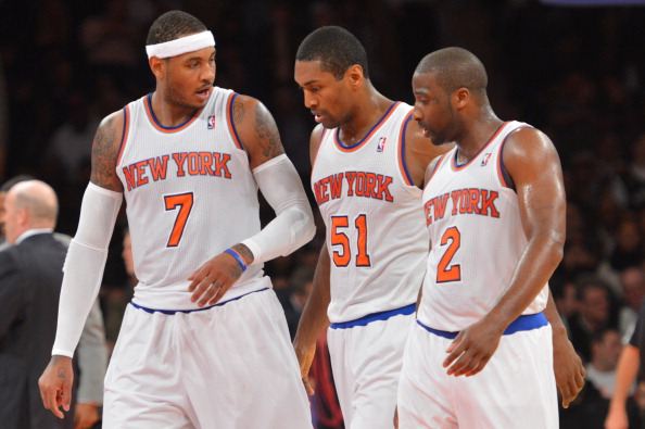 NEW YORK, NY - NOVEMBER 5: (L-R) Carmelo Anthony #7, Metta World Peace #51 and Raymond Felton #2 of the New York Knicks talk on the court against the Charlotte Bobcats during the game on November 5, 2013 at Madison Square Garden in New York City, New York. NOTE TO USER: User expressly acknowledges and agrees that, by downloading and or using this photograph, User is consenting to the terms and conditions of the Getty Images License Agreement. Mandatory Copyright Notice: Copyright 2013 NBAE (Photo by Jesse D. Garrabrant/NBAE via Getty Images)